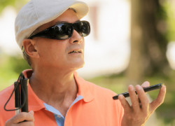 blind man using voice command on smartphone