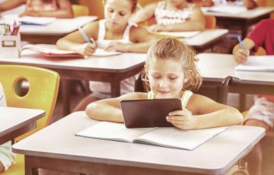 School kids studying in classroom at school