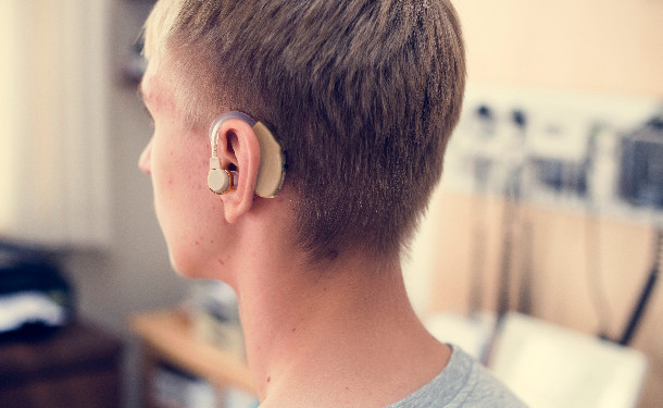 young-man-with-hearing-aid