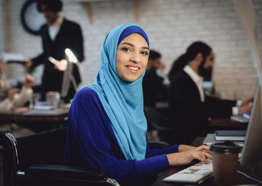 Arabian lady in wheelchair working