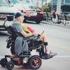 Man crossing road in wheelchair
