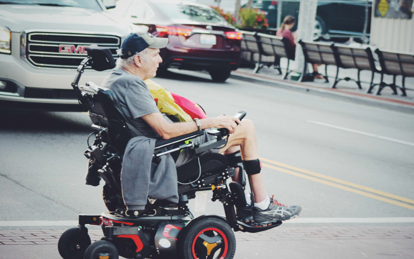 Man crossing road in wheelchair