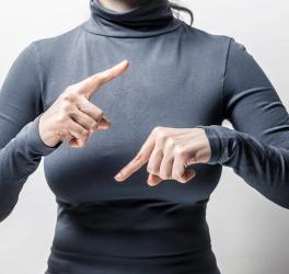 Woman speaks sign language