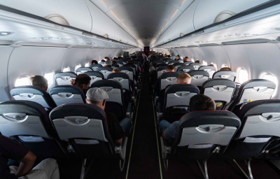 Single-Aisle Airplane cabin seats with passengers