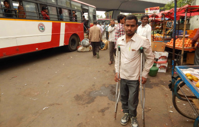 young man with disability wait for bus in a bus terminal