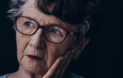 Elderly lonely woman with Alzheimer