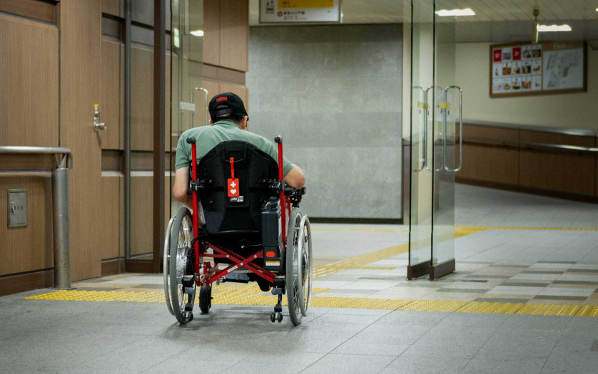 Wheelchair user entering in the building in Tokyo