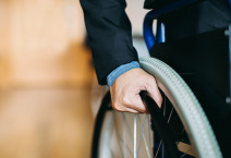 close up hands for a wheelchair user