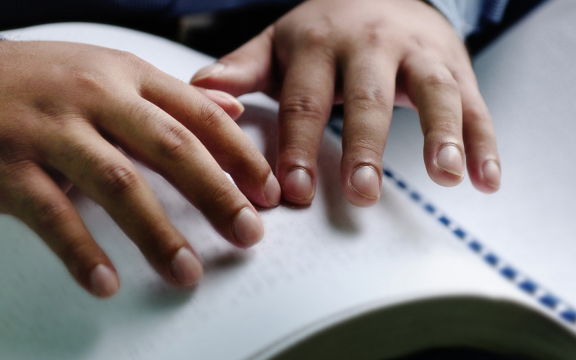 blind person reading braille