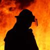 One firefighter rescue worker at wild fire bushfire blaze.