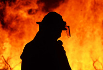 One firefighter rescue worker at wild fire blaze.