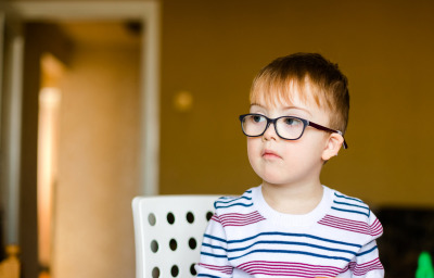Little boy in the glasses with disability