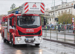 Fire brigade workers are riding fire truck crane in Prague, Czech Republic