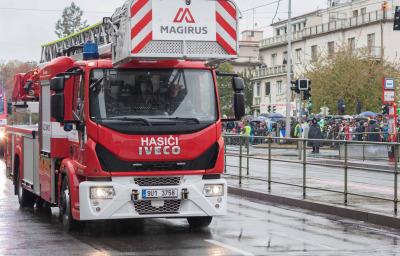 Fire brigade workers are riding fire truck crane in Prague, Czech Republic