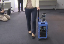 Chieko Asakawa is demonstrating how to use a AI suitcase