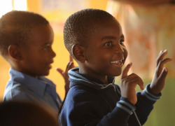 African kid smiling in the school