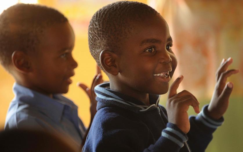 African kid smiling in the school