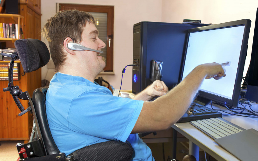 a person in wheelchair using computer