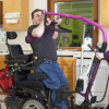 a man with disability doing exercise at home