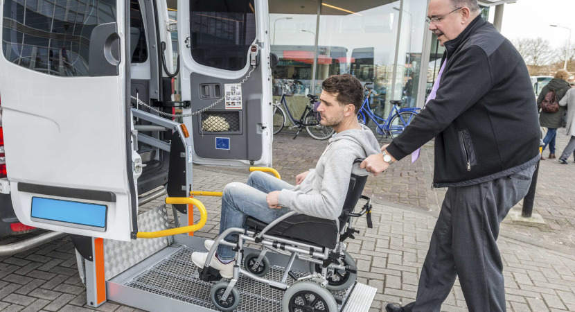 A driver helping the wheelchair user