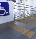 Accessibility sign with ramp