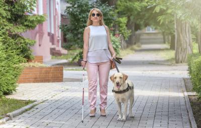 a blind woman walking in the street