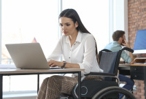 woman in wheelchair working on laptop