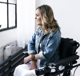 a woman in wheelchair at home