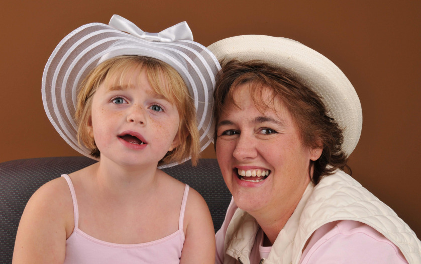 girl with Down Syndrome with her mother