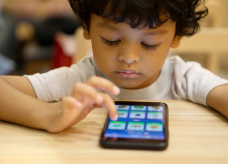 kid with disability using smartphone