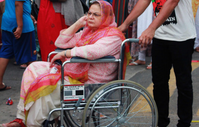 Pakistani woman in wheelchair during a rally