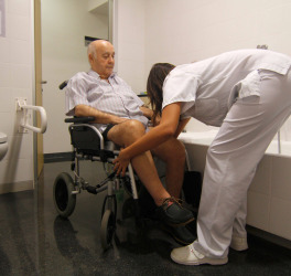 Patients who have suffered a stroke perform recovery activities with the help of nurses in the recovery program at Hospital