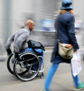 blurred movement disabled man on a city street