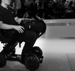 wheelchair user leaving the building
