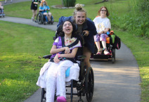 smiling girl in wheelchair with friend