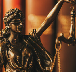 Blindfolded justice holding up the scales