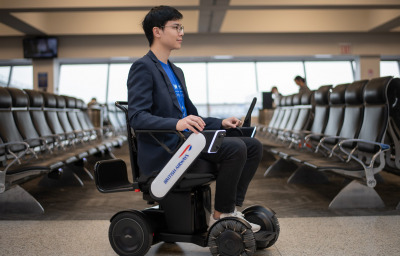 a passenger using the wheelchair at airport