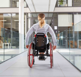woman in a wheelchair on the move in the building