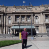Alex in front of the building posting for photo