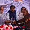 Asif Iqbal Chowdhury receiving award from the Prime Minister of Bangladesh
