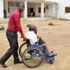 a man pushing a person in wheelchair