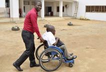 a man pushing a person in wheelchair