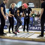 a woman athletes participating in Cybathlon