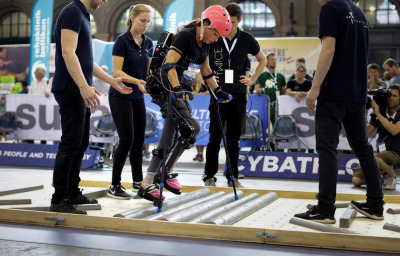 a woman athletes participating in Cybathlon