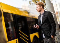 man using mobile to track bus
