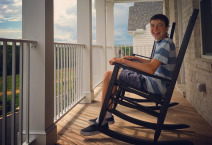 a teenage with autism relaxing with rocking chair