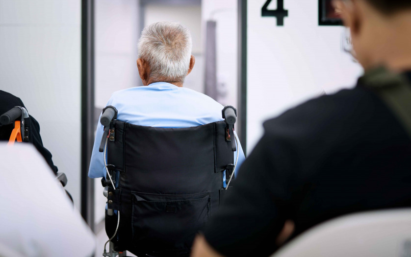 Patient elderly sitting on wheelchair while waiting a doctor to treat