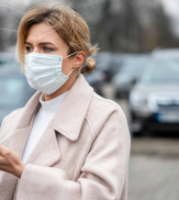 Portrait of blonde woman with surgical mask