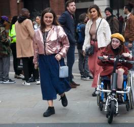 women outside with a women in wheelchair
