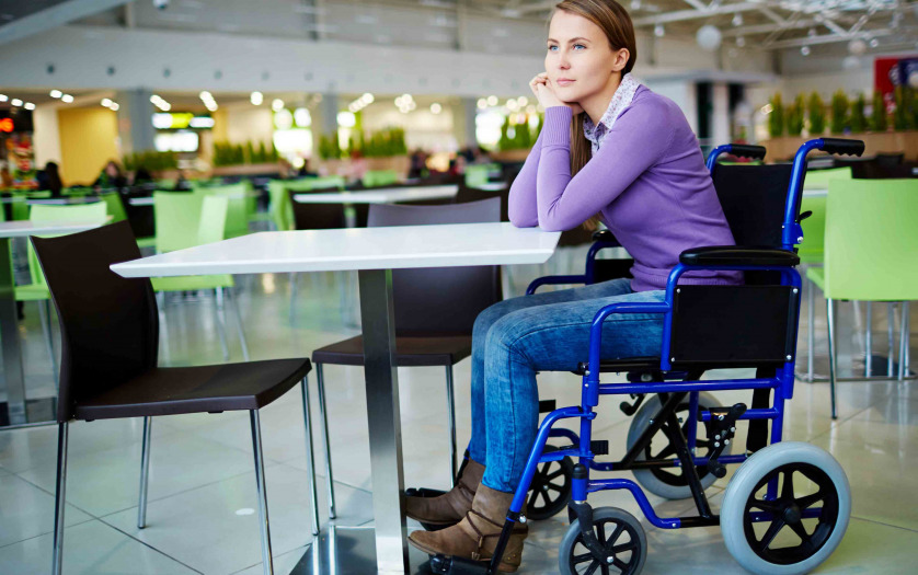 woman in wheelchair at the empty food court